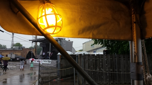 Saturday rain, from under the Lions Club beer tent toward the Festival Stage.