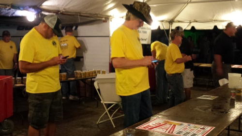 Phone checking in parallel, Saturday, under the Lions Club beer tent.