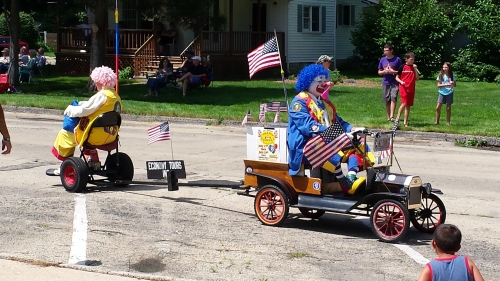 At the parade Sunday, this blue-haired clown shouted,
