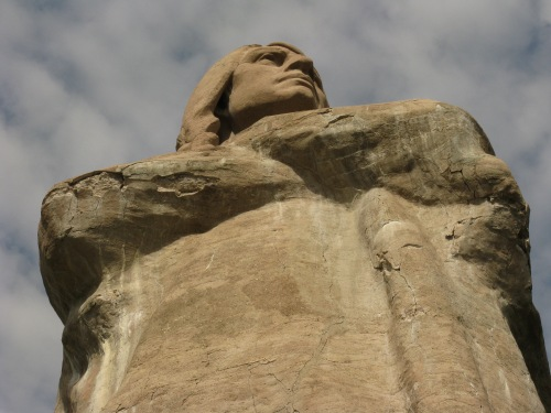 Photo of the 48-foot tall statue from below, taken Sept. 2011 and showing some of the damaged concrete.