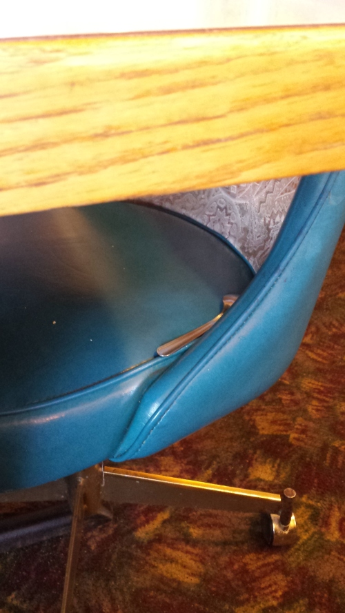 """A spoon in the chair at my local diner. Our diner employee friend Amin said we could replace it with a fork to surprise the next sitter. Then he said, """"Just put a bear trap. Fukk it."""" 6 Dec."""