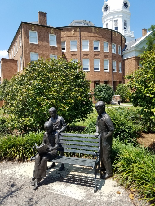 Statues of children reading, south of Old Courthouse.