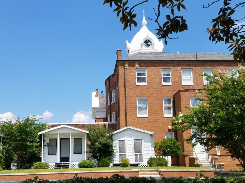 View of Old Courthouse's west side. The little houses are sets for the annual productions of a play of To Kill a Mockingbird put on by local actors.