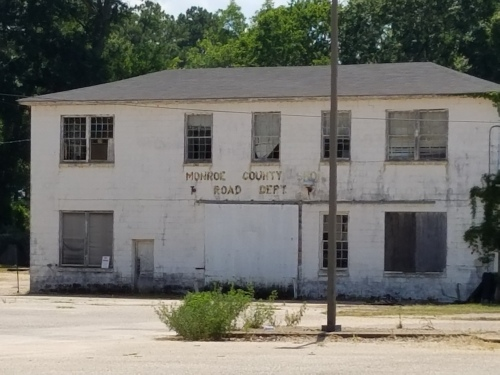 Another run-down-looking building in downtown Monroeville, on west side of Mt. Pleasant Ave, southwest of Old Courthouse.