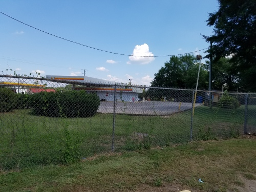 Fence between school playground and Cannon gas station -- former Boulware house.