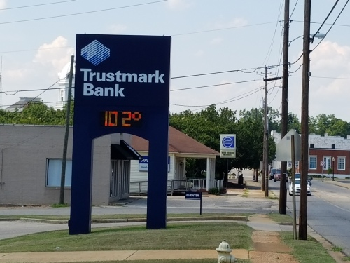 View north along Alabama Ave. Note the Old Courthouse to left of bank sign and brick white house to the right. Temperature was as of 2:55 p.m. 25 June.