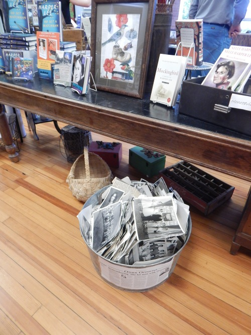 In the Bird's Nest gift shop, among the postcards, books, and t-shirts, there's a metal tub of old photos. Museum staffer George Jones explained that these photos belonged to a town photographer and local people come in and dig through the photos and buy ones they like for a dollar a piece.