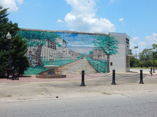 Mural on east wall of building at southwest corner of Claiborne and Alabama, southeast of courthouse and diagonal from the post office.
