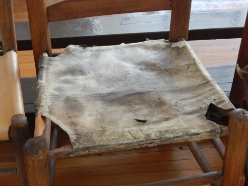 Cowhide-seated jury chairs.