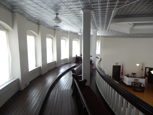 The third-floor balcony from where, in the book, Scout, Jem, Dill, Rev. Sykes, and others watched the trial. While the courtroom seemed to be air-conditioned when we were there, the third-floor landing was not, and it was noticeably warmer than the second-floor courtroom was.