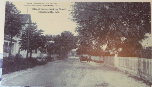 View south on Alabama Avenue from an image at the Old Courthouse. Caption says the view is dated 1915 and the car is in front of the Lee house.