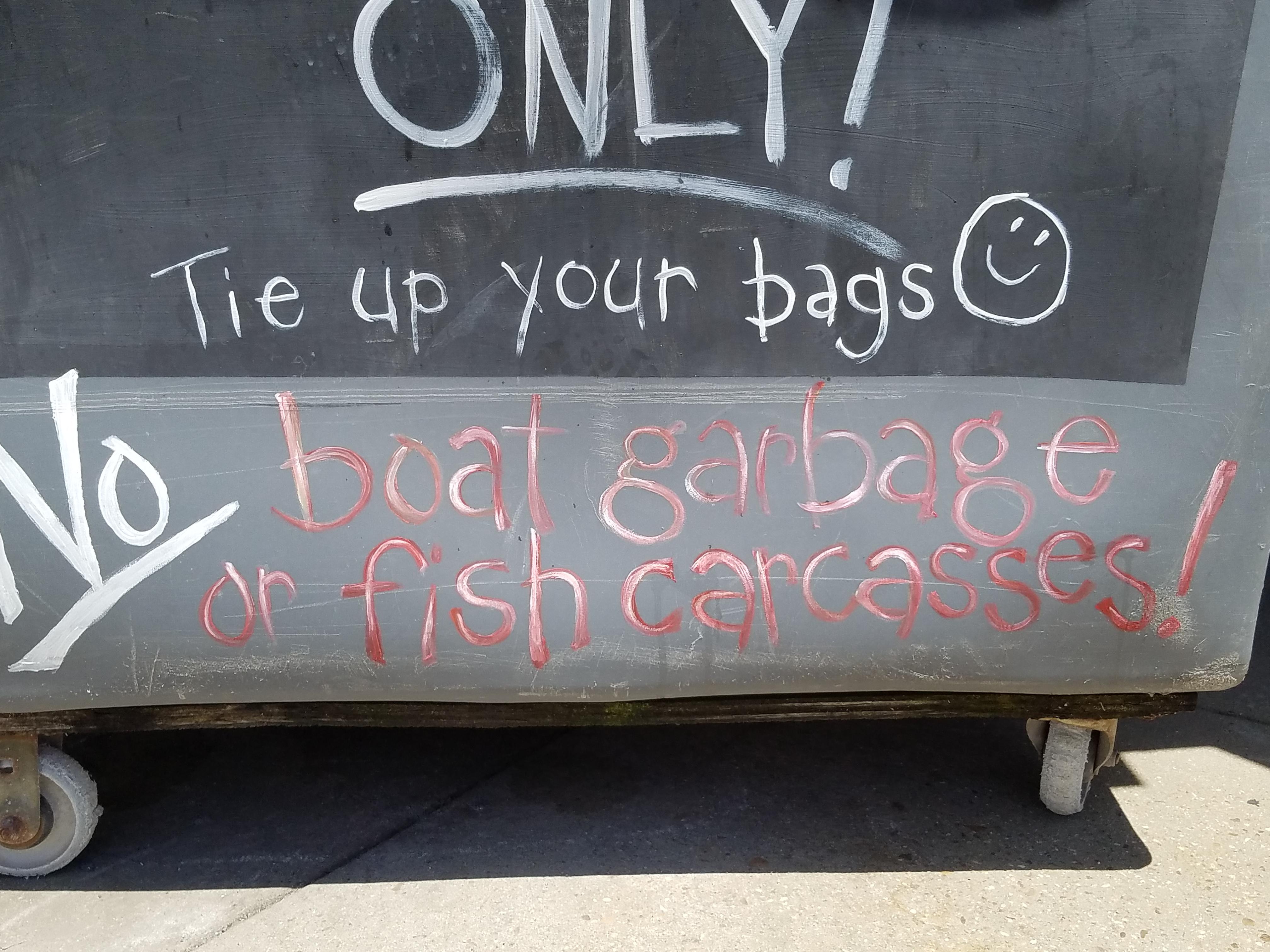 Garbage bin at the marina: No fish carcasses!