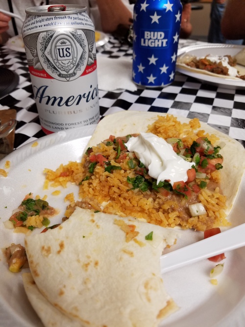 A can of America with Mexican food.